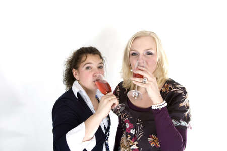 Two women are drinking red champagne photo