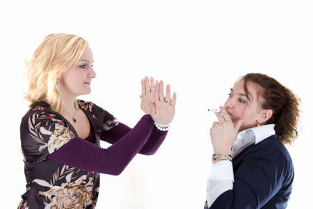 A woman is telling another to stop smoking photo