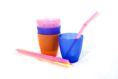 Different colored cups and straws on a white background. Stock Photo - 6893144