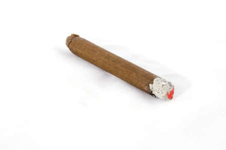 A burning cigar on a white background. Stock Photo