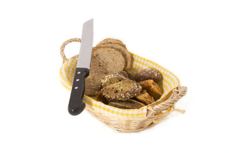 Some and a knife in a basket on a white background. Stock Photo