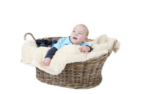 Little boy in a basket looking up