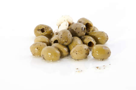 Olives in oil on a white background. Stock Photo