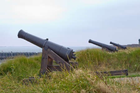 Multiple canons at the coast line. Stock Photo