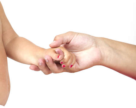 A mother is holding the hand of her daughter. Stock Photo - 7481891