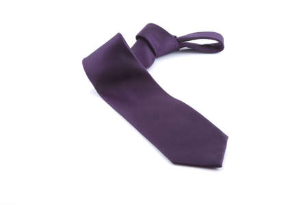Purple tie with knot on a white background. Stock Photo - 7666340