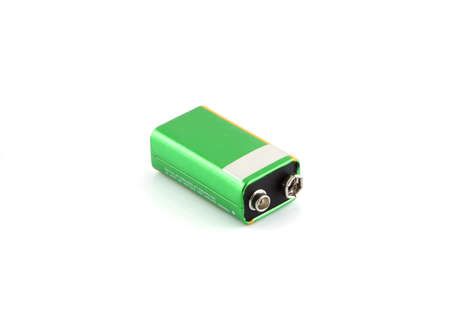 9v battery: A green battery on a white background. Stock Photo