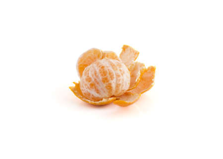 A mandarin is peeled on a white background. Stock Photo
