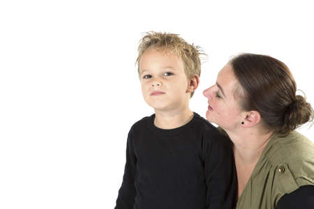 A mother is telling her son something. Stock Photo