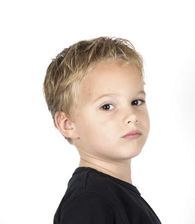 Portarait of a young boy on a white background. Stock Photo - 7940939
