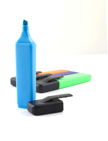 Blue marker standing up on a white background. photo