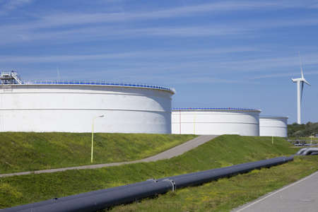 Large oil reservoirs outdoors. photo
