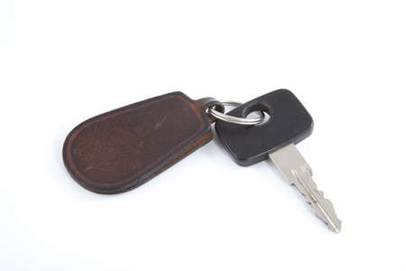 Car key with label on a white background. Stock Photo