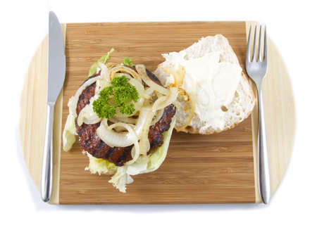 Hamburger sandwich on a plate with cutlery. Stock Photo - 8190527