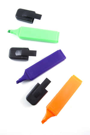 Several markers on a white background. photo