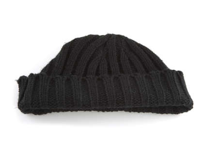 Single black cap on a white background. photo
