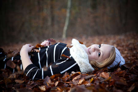 Young teenager in the mood for autumn photo