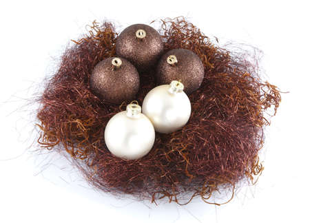 A small nest of christmas balls on a white background. Stock Photo - 8419940