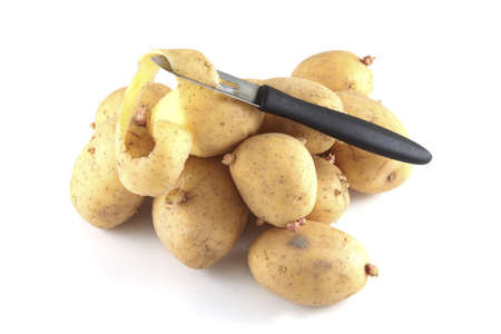 pealing: Pealing potatoes on a white background. Stock Photo