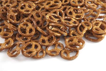 pretzel stick: A lot of pretzels on a white backgorund.