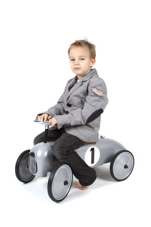 Little boy is driving a toy vehicle Stock Photo - 8608636