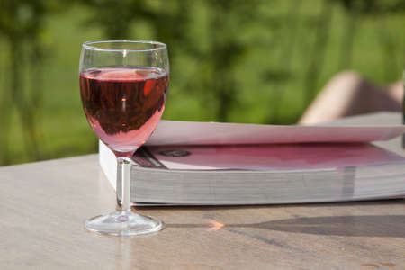 Still life of a glass of wine and a book. photo