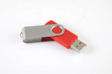 Red USB Stick on a white background. Stock Photo