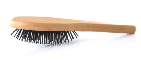 Wooden hair brush on a white background.