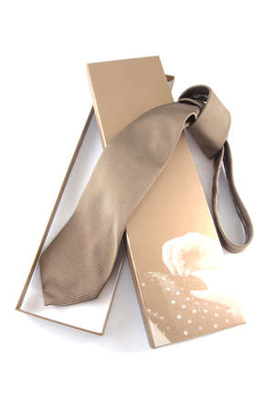Bronze neck tie in a gift box on a white background. Stock Photo - 9238673