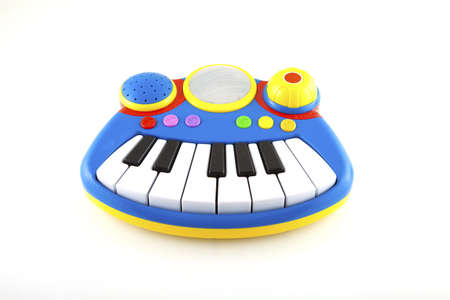 Small piano as toy on a white background.