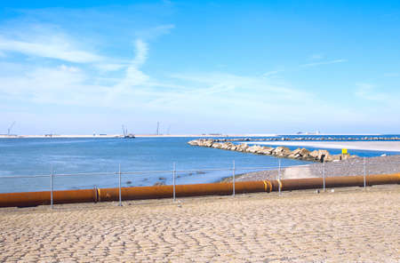 Coastal view at the the Maasvlakte with blue sky Stock Photo