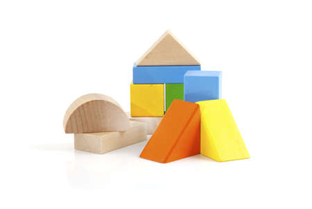 Wooden toy blocks on a white background.