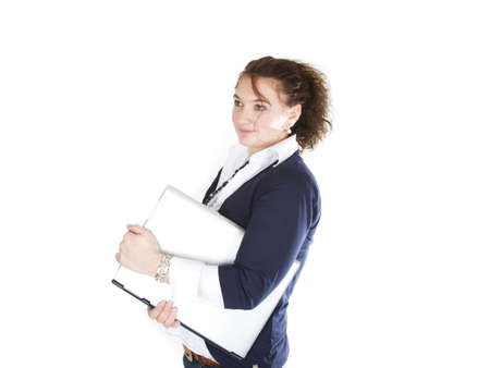 Woman is holding a notebook on a white background. Stock Photo