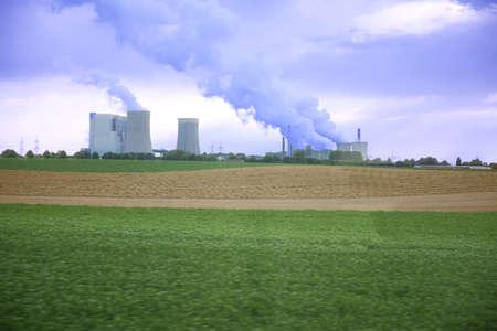 Heavy industry in the middel of large fields.