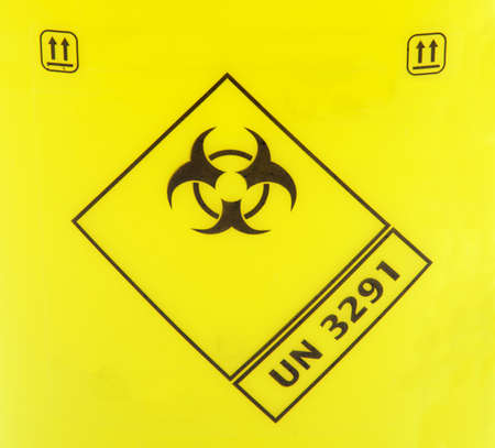 Biohazard sign on a yellow background.