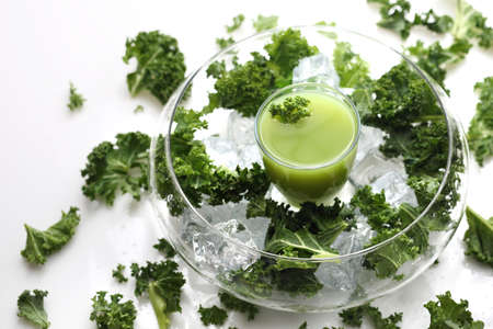 Green, vegetarian, healthy fruit and vegetable cocktail with fresh green vegetables and fruits. Composition from above on a white background.
