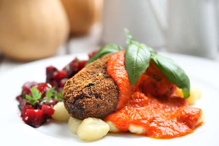 Pumpkin cutlets served with tomato sauce on dumplings on gnocchi, roasted beet salad.