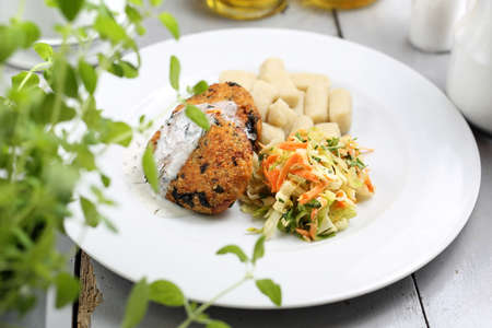 Vegetarian lunch, healthy vegetable cutlet with dumplings and white cabbage salad. Stock Photo