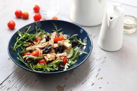 A plate of appetizing healthy, vegetarian lettuce on a white table. Reklamní fotografie