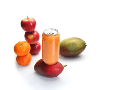 A can of fresh squeezed tropical fruit juice on a white background. Mango fruits, mandarins, oranges, apples.