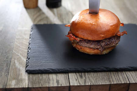 Burger. Grilled beef cutlet in a bun. Stock Photo