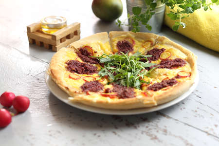 Vegetarian pizza with vegetables, green arugula and tomato pulp. Horizontal frame