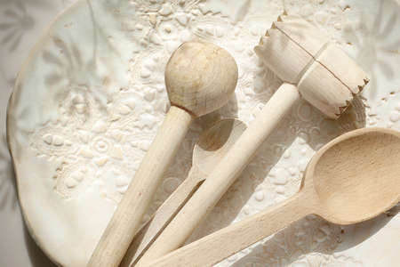 Natural vintage wooden kitchen accessories on a light background. Horizontal composition. Imagens