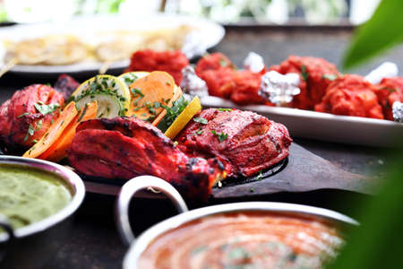 Traditional aromatic Indian cuisine. Colorful curry and meat. Thai restaurant.