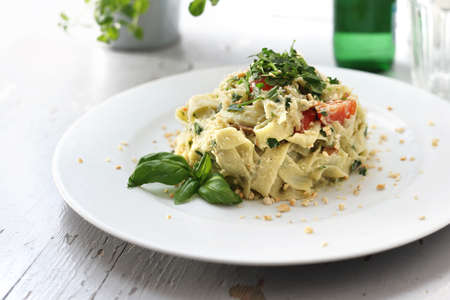Appetizing vegetarian lunch, pasta with vegetables. Horizontal composition.