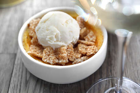 Dessert of cream brulee with ice cream and sesame in caramel.
