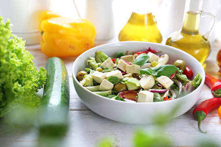 Food, appetizing salad served on a plate. Healthy diet. Vegetarian dish. 版權商用圖片
