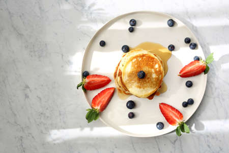 Traditional home-made pancakes, sweet, nutritious breakfast. horizontal frame, top view