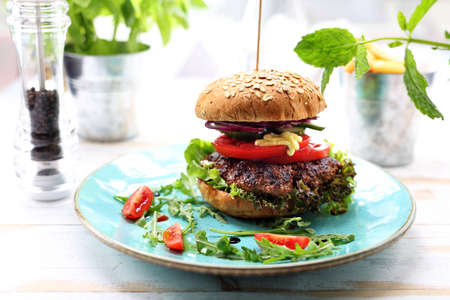 Food, appetizing burger on the plate, photo of food, offering food