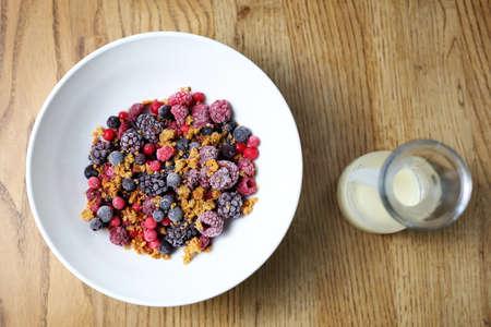 Light, appetizing breakfast. Blueberries with homemade granola and Greek yogurt. Horizontal composition.